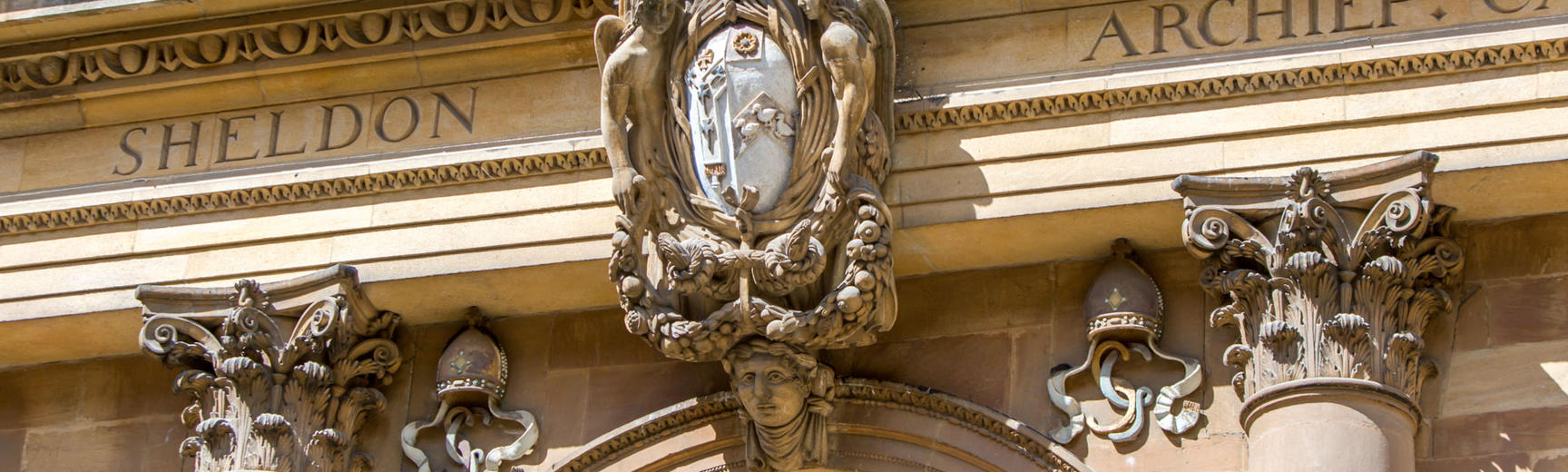 Image of external detailing above a window of the Sheldonian Theatre