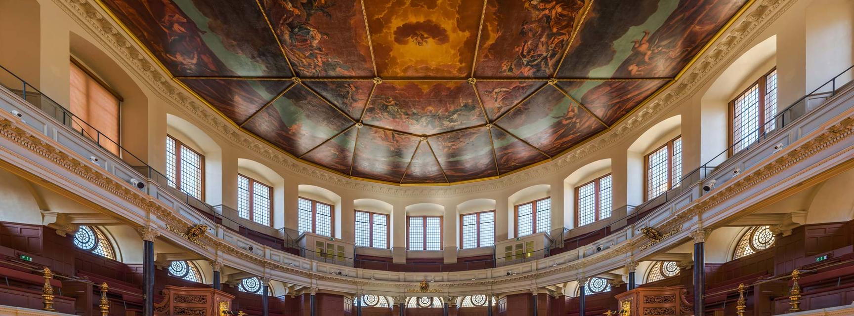 Photo of the inside of the Sheldonian Theatre with full view of the painted ceiling